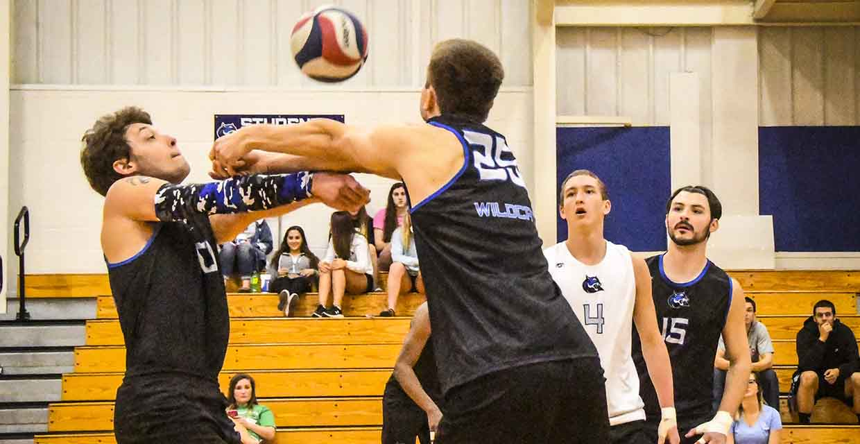 Evan Winter and Jordan Stellflue battle for a dig during Friday's match